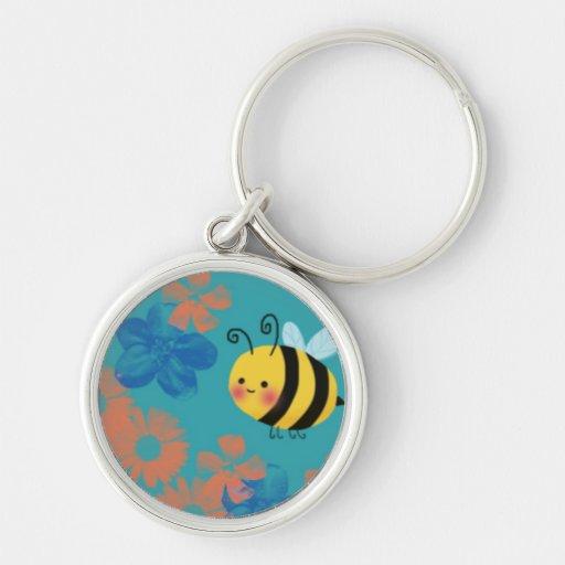 Ocupados lindos manosean la abeja llavero redondo plateado