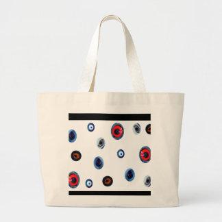 Odd Eyes Tote Bags