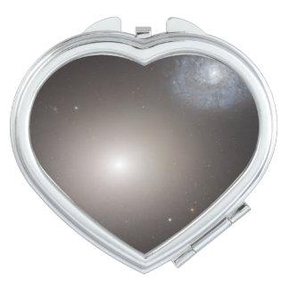 Odd Galaxy Couple on Space Voyage Vanity Mirror