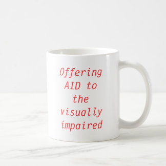 Offering AID to the visually impaired Coffee Mug