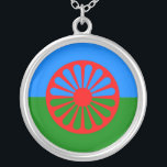 """Official Romany gypsy flag Silver Plated Necklace<br><div class=""""desc"""">Easily personalize this green and blue official Romani Roma gypsy flag of the romany gipsies &amp; travellers with your own text by using the customize menu. The flag represents the green of the earth and the blue of the sky with a traditional gypsy caravan vardo wagon wheel, representing travel.</div>"""