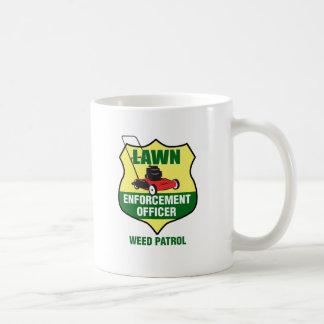 Oficial de la aplicación del césped taza de café