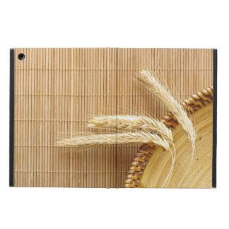 Oídos del trigo en la placa de madera