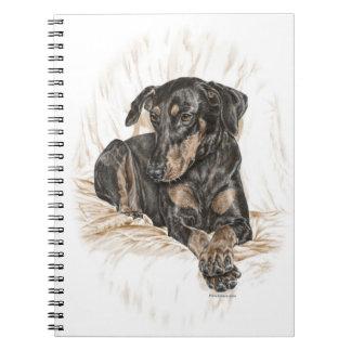 Oídos naturales del perro del Doberman Cuadernos