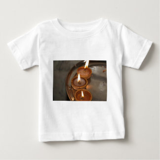 Oil lamps kept in a plate during Diwali T Shirts