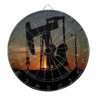 Oil Pump Jack At Sunset Dart Board
