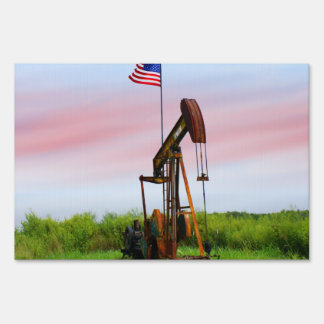 Oil Pump With American Flag Lawn Sign