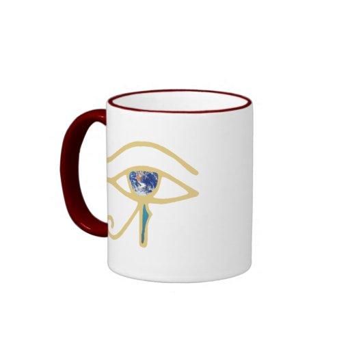 Ojo del oro de la tierra tazas de café