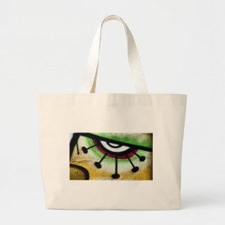 Ojo grande y colorido graffitti. bolsa tela grande
