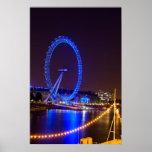 Ojo iluminado de Londres de la rueda en la noche Impresiones