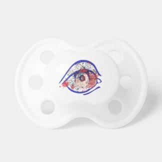 Ojo inyectado en sangre azul con las grietas chupete