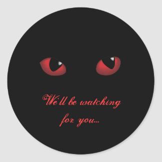 Ojos asustadizos rojos que miran para usted a los etiqueta redonda