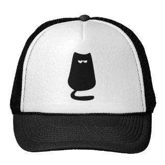 Ojos del negro del gato que se sientan hola gorros