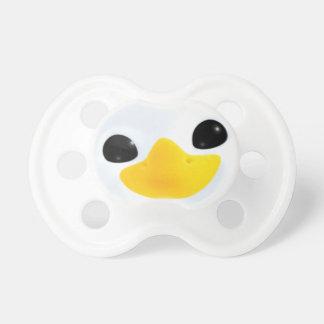 Ojos del pingüino del dibujo animado chupete
