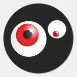 Ojos del rojo pegatina redonda