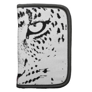 Ojos negros y blancos del leopardo planificador