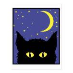 Ojos que brillan intensamente del gato tarjetas postales