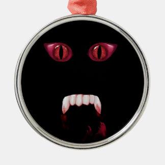 Ojos rojos malvados del demonio y colmillos adorno de reyes
