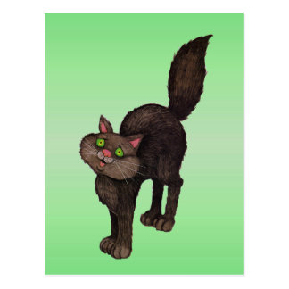 Ojos verdes lindos del gato negro postales