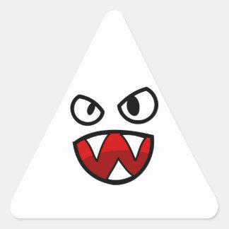 Ojos y boca del monstruo del dibujo animado con pegatina triangular