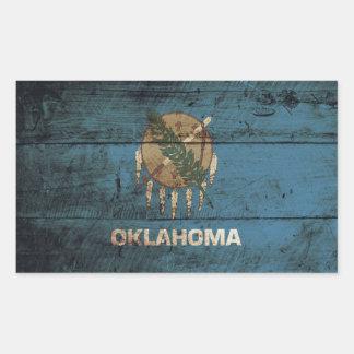 Oklahoma State Flag on Old Wood Grain Rectangular Sticker