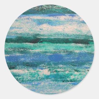 Olas oceánicas etiqueta redonda