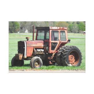 Old And Rusted Red Tractor Sitting Still Canvas Print