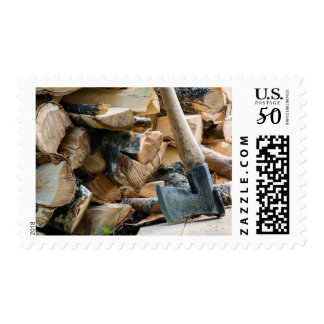 Old axe and firewood postage