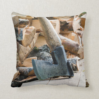 Old axe and firewood throw pillow