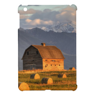 Old barn framed by hay bales and dramatic cover for the iPad mini
