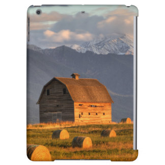 Old barn framed by hay bales and dramatic iPad air cover