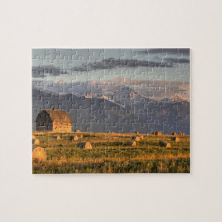 Old barn framed by hay bales and dramatic jigsaw puzzle