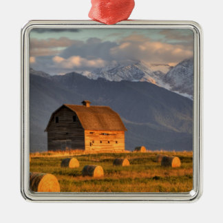 Old barn framed by hay bales and dramatic christmas ornaments