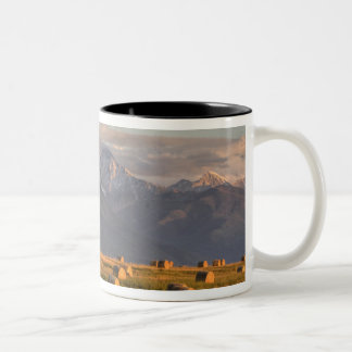 Old barn framed by hay bales and dramatic Two-Tone coffee mug