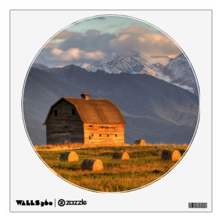 Old barn framed by hay bales and dramatic wall sticker