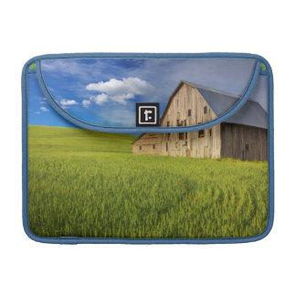 Old Barn in Field of Spring Wheat Sleeve For MacBook Pro