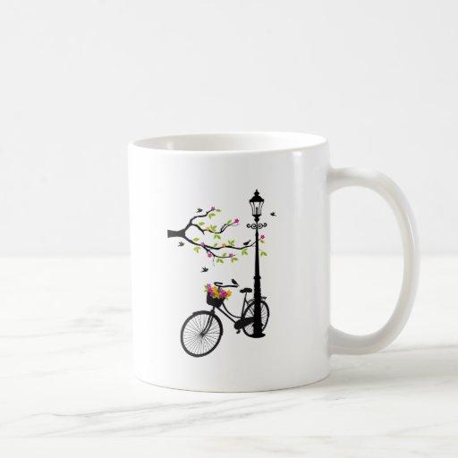 Old bicycle with lamp, flower basket, birds, tree coffee mug