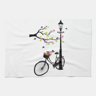 Old bicycle with lamp, flower basket, birds, tree towels