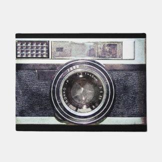 Old black camera doormat
