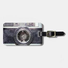 Old black camera luggage tag