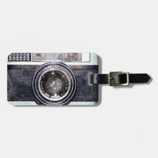 Old black camera tags for bags