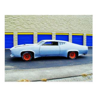 Old blue car in Boston, Massachusetts. Postcard