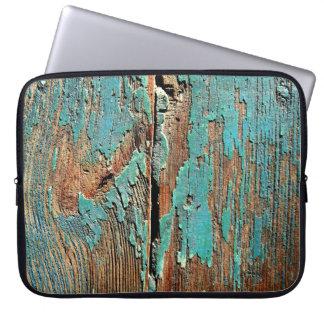 Old blue paint on wood computer sleeve