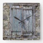 Old blue painted wood shutters clock