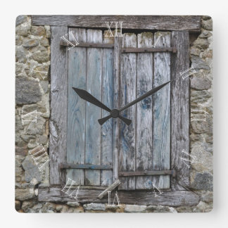 Old blue painted wood shutters square wall clock