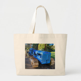 Old blue tractor and crawler large tote bag