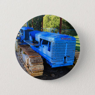 Old blue tractor and crawler pinback button