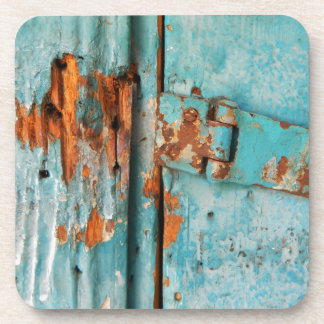 Old blue wooden door with rusted latch beverage coaster