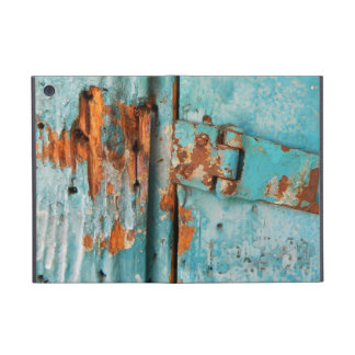 Old blue wooden door with rusted latch cover for iPad mini