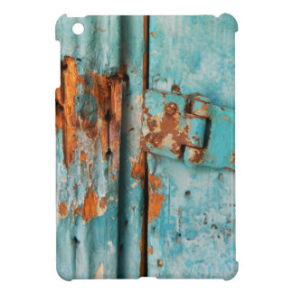 Old blue wooden door with rusted latch iPad mini cases